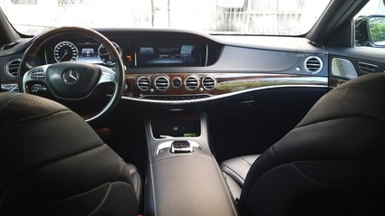 Black Mercedes Benz S-Class from inside back side